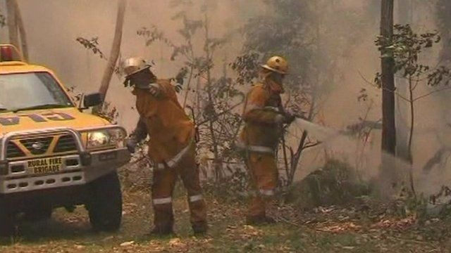 Two fire fighters tackle blaze