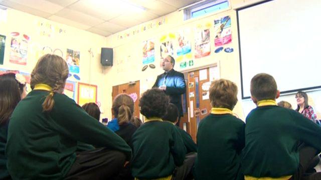 Children at Ysgol Esgob Morgan in St Asaph have a reading session