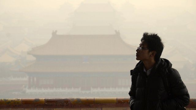 A Chinese man in front of the the Forbidden City in Beijing