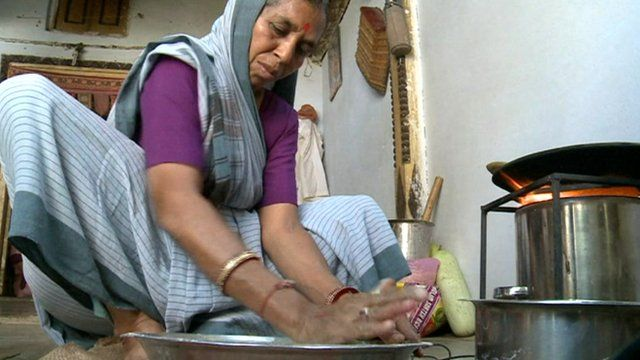 Woman cooking in India