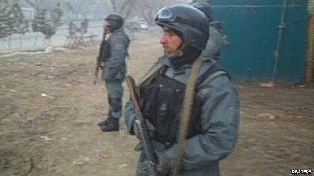 Afghan soldiers hold weapons
