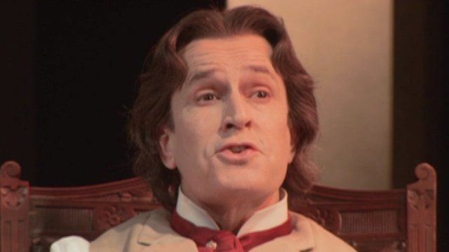 Rupert Everett playing Oscar Wilde