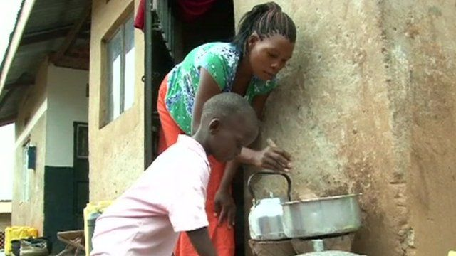 A mother and son prepare a meal outdoors