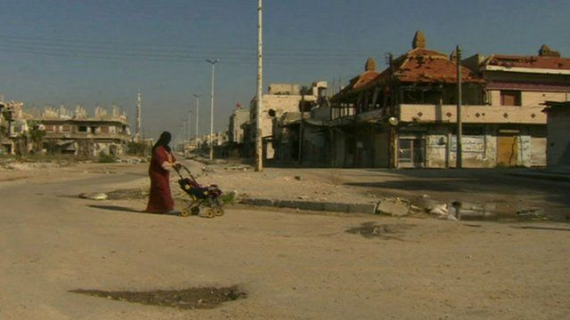 Woman walking in Baba Amr district of the central Syrian city of Homs