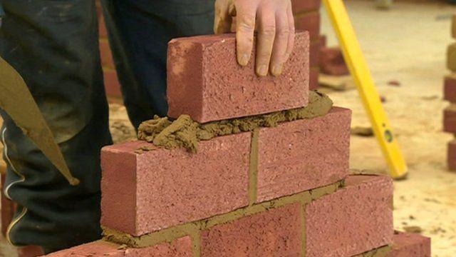 Trainee laying bricks