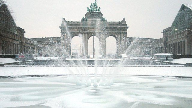 A fountain sprays water during freezing temperatures at the Cinquantenaire park in Brussels