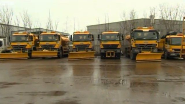 Snow ploughs and gritting lorries