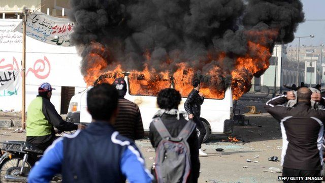 Burning minibus outside Port Said prison