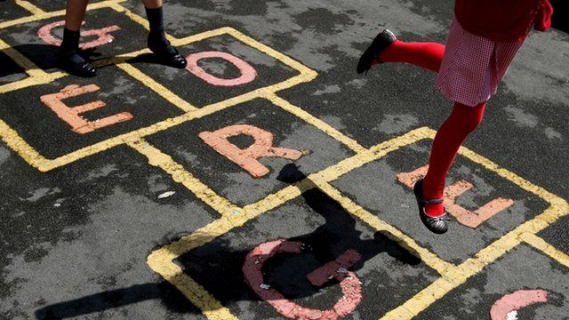 Primary school children playing hop-scotch during playtime