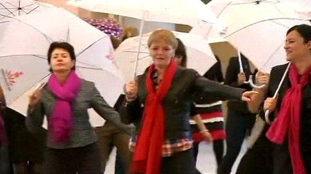 Women dancing with umbrellas