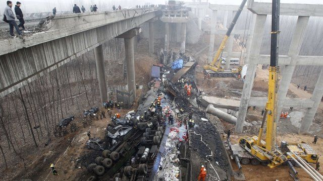 Rescuers work under the collapsed Yichang bridge near the city of Sanmenxia, central China