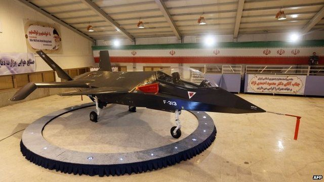 Iran's domestically designed and built Qaher F-313 fighter jet is unveiled during a ceremony in a warehouse in Tehran, 2 February 2013