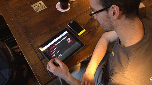 Stephen Baldwin looking at his iPad