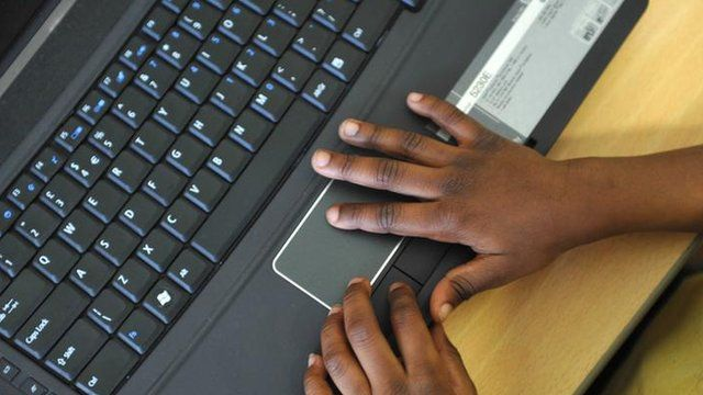 Child's hands on keyboard
