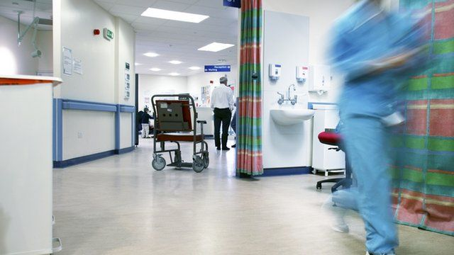 Empty wheelchair on a hospital ward