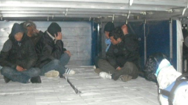 People in the back of a lorry