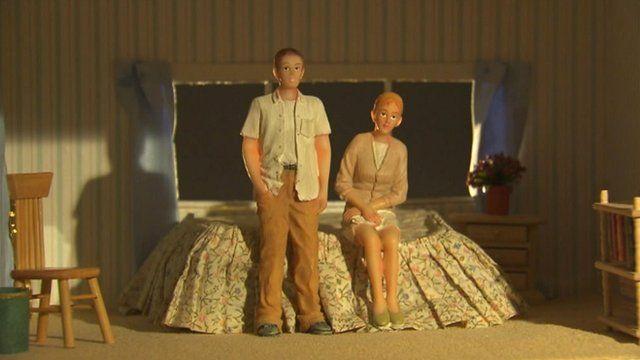Model figures in a toy bedroom