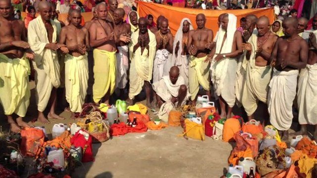 Group of men from North Indian state of Bihar praying to Ganges
