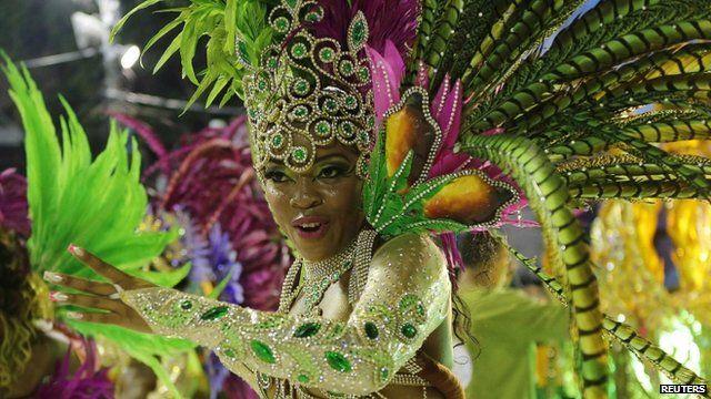 A reveller participates during the annual carnival parade in Rio de Janeiro's Sambadrome