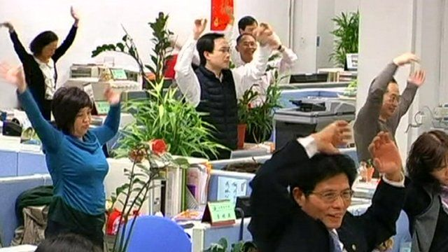Taiwanese workers exercise at their desk