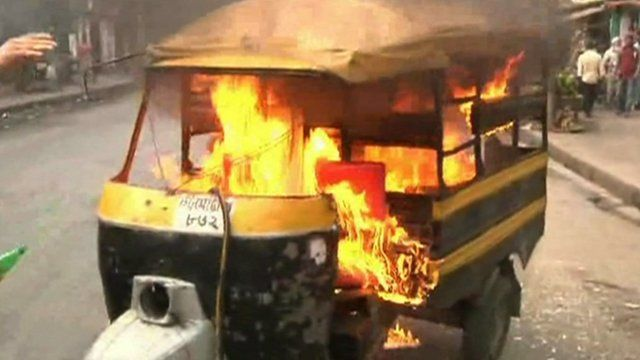 A vehicle is set alight during protests