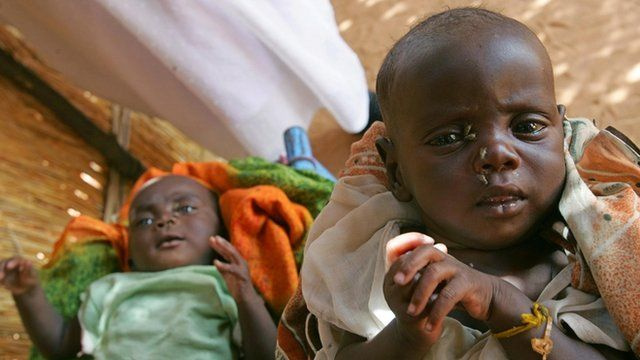 Sudanese brother and sister wait to be attended by medical staff