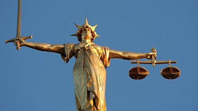 The figure of Lady Justice, at the top of the dome of the Central Criminal Court, London