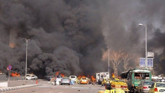 The aftermath of what police said was a powerful car bomb explosion near the headquarters of Syria's ruling Baath party
