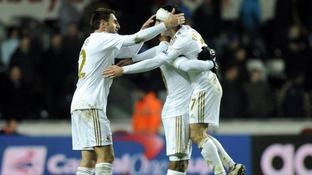 Swansea players celebrate getting through to the Capital One Cup final