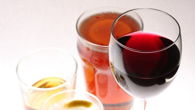 Alcoholic drinks: a pint of beer, a glass of whisky, a gin and tonic and a glass of red wine,