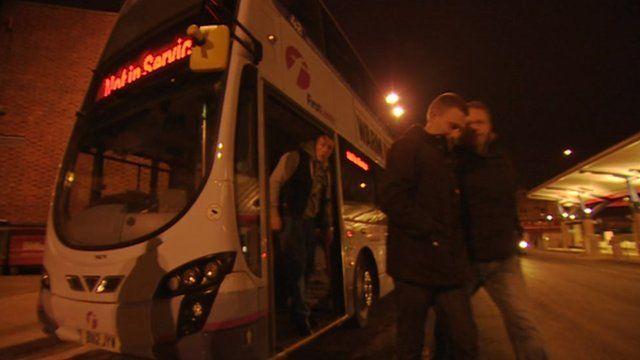 Men getting off a double decker bus