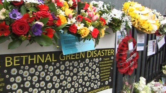 Floral tributes are laid on railings outside Bethnal Green tube station