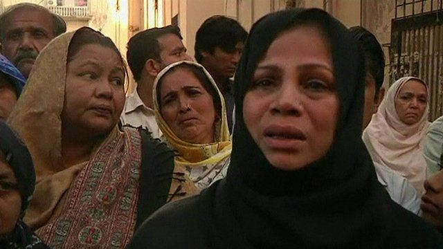 A woman speaking to reporters in the aftermath of the Karachi blast