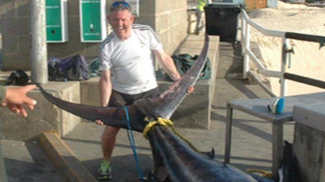 Man holding large marlin