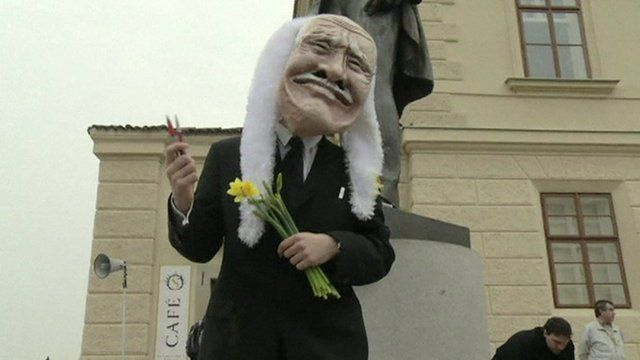 Man dressed in costume of outgoing Czech president Vaclav Klaus
