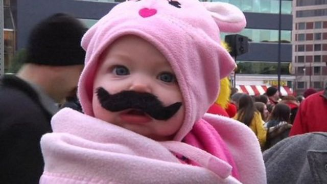 Baby wearing fake moustache