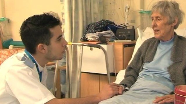 Portuguese nurse Vitor Martins with patient