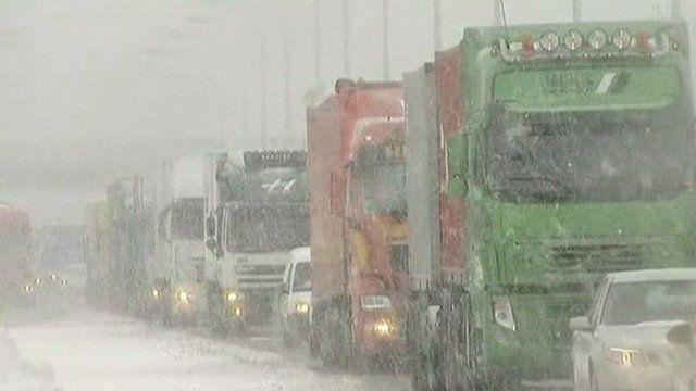 Traffic on a motorway during snowfall