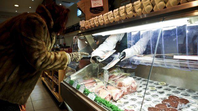 Woman at a butcher shop