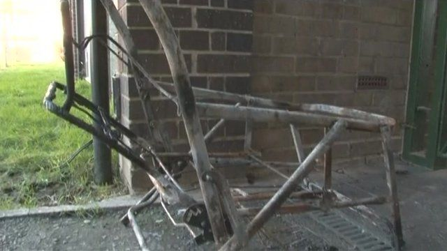 The remains of a child's pram which has been burned
