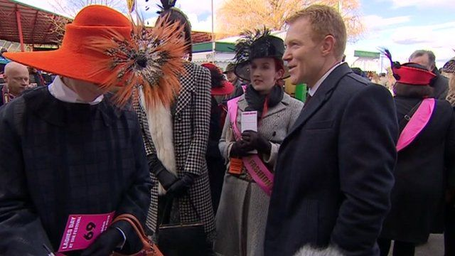 Adam Henson talks with a group of women at the National Hunt Festival in Cheltenham