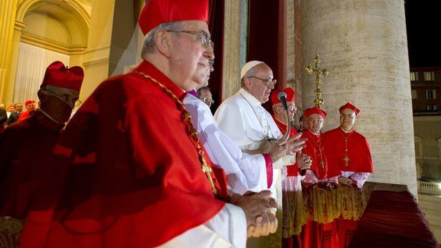 Cardinals flank Pope Francis