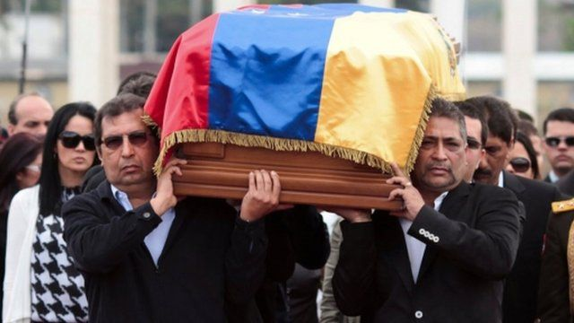 Hugo Chavez brothers carry his coffin