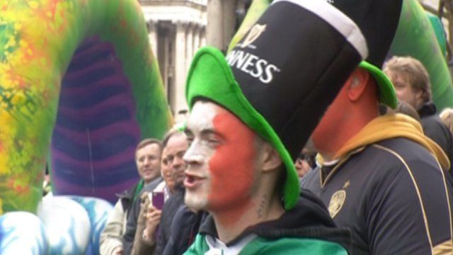 A man watches the St Patrick's Day parade