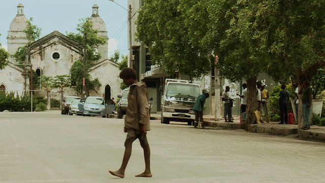 A street scene in Quelimane with the city's cathedral in the background