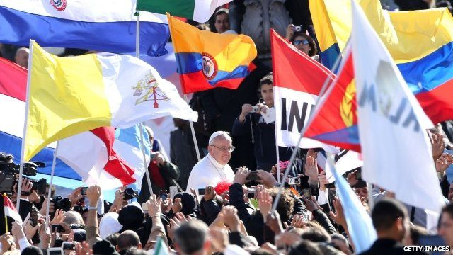Pope surrounded by crowds