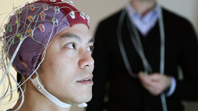 Kevin Fong in an EEG cap which measures the brain's response to making mistakes
