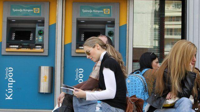 People sat outside bank