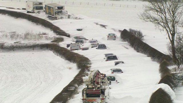 Vehicles buried in snow drifts in Cumbria