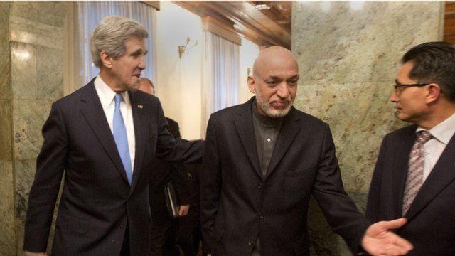 Afghan President Hamid Karzai and US Secretary of State John Kerry a